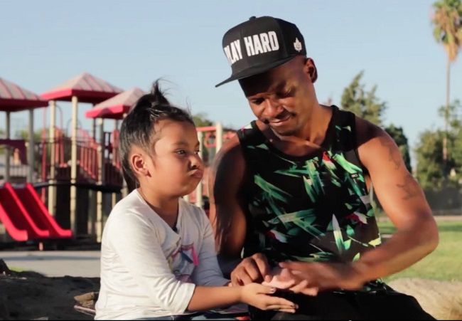 Fashawn-with-his-daughter