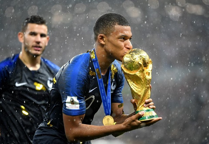 kylian mbappe with fifa world trophy