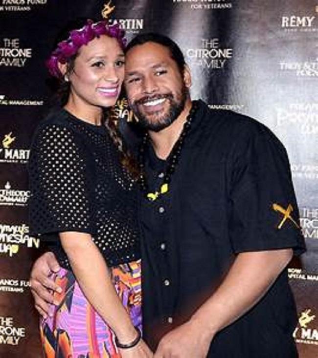 Theodora Holmes with husband Troy Polamalu